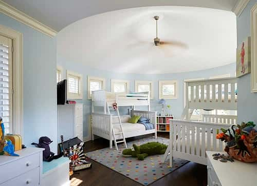 Circular bunkroom with white bunks