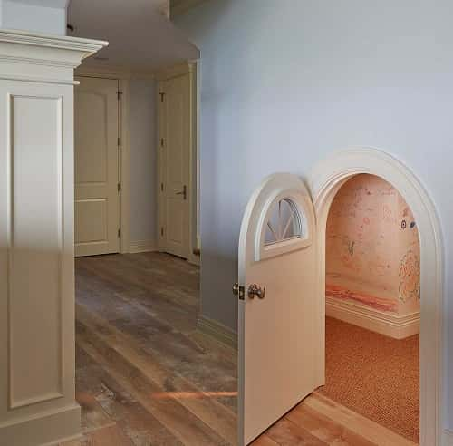Hobbit playroom with miniature arched door